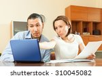 couple with financial... | Shutterstock . vector #310045082