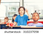 portrait of cute boy raising... | Shutterstock . vector #310237058