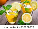 lemonade with fresh lemon and... | Shutterstock . vector #310250792