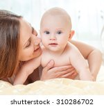 mother and baby playing and... | Shutterstock . vector #310286702