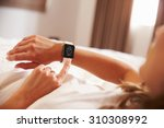 woman lying in bed woken up by... | Shutterstock . vector #310308992