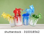 colored paint buckets splashing ...   Shutterstock . vector #310318562