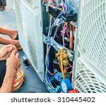 Small photo of Air Conditioning Technician and A part of preparing to install new air conditioner.