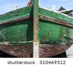 Weathered Old Green Fishing Boat