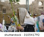 Religious Jews sunrise prayer service at the Western Wall, Jerusalem, Israel - stock photo