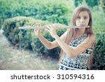Young Girls Playing The Flute