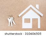 silver key with house figure... | Shutterstock . vector #310606505