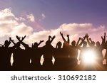 silhouetters celebrating... | Shutterstock . vector #310692182