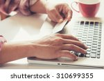 man's hands holding a credit... | Shutterstock . vector #310699355