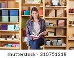 portrait of smiling female... | Shutterstock . vector #310751318