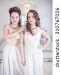 two beautiful young women in... | Shutterstock . vector #310767026