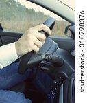 hand holding car key for... | Shutterstock . vector #310798376