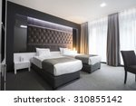 Stock photo interior of a double bed hotel room 310855142