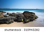 Rocky Coastline With Sand And...
