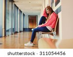 caucasian female student... | Shutterstock . vector #311054456
