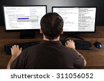 young man programming code on... | Shutterstock . vector #311056052