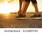 female getting ready for a run... | Shutterstock . vector #311084765