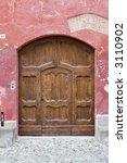 ancient wood door in saluzzo  a ... | Shutterstock . vector #3110902