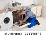 young repairman fixing... | Shutterstock . vector #311145548