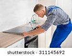 young repairman installing... | Shutterstock . vector #311145692