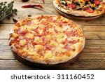 hawaiian  pizza  rustic table... | Shutterstock . vector #311160452