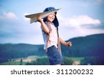 happy kid playing with paper... | Shutterstock . vector #311200232