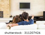 young couple watching tv | Shutterstock . vector #311207426