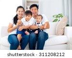 portrait of asian family | Shutterstock . vector #311208212