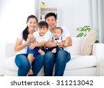 portrait of asian family | Shutterstock . vector #311213042