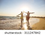 young family on the beach | Shutterstock . vector #311247842