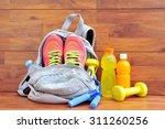 sport equipment on wooden floor.   Shutterstock . vector #311260256