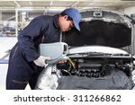 car mechanic replacing and... | Shutterstock . vector #311266862