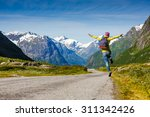 young hipster female traveler... | Shutterstock . vector #311342426