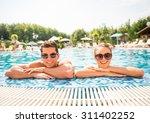 young couple relaxing in resort ... | Shutterstock . vector #311402252