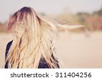 back view of the young female... | Shutterstock . vector #311404256