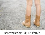kid with boot stand and wait on ... | Shutterstock . vector #311419826