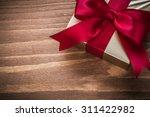 packed glittery gold present... | Shutterstock . vector #311422982