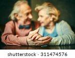 close up of hands of elderly... | Shutterstock . vector #311474576
