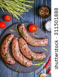 raw sausage of beef and pork... | Shutterstock . vector #311501888