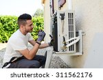 handsome young man electrician...   Shutterstock . vector #311562176