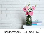 beautiful flowers with books on ... | Shutterstock . vector #311564162