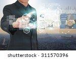 businessman holding virtual... | Shutterstock . vector #311570396