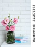 beautiful flowers with books on ... | Shutterstock . vector #311578595