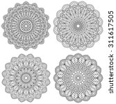 set of ethnic round ornaments.... | Shutterstock .eps vector #311617505