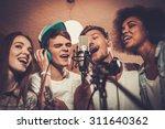 multiracial music band... | Shutterstock . vector #311640362