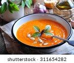 vegetarian pumpkin soup with... | Shutterstock . vector #311654282