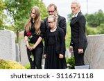 family on cemetery or graveyard ... | Shutterstock . vector #311671118