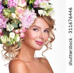 beautiful woman with flowers in ... | Shutterstock . vector #311676446