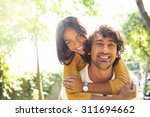 portrait of a smiling couple... | Shutterstock . vector #311694662