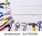 set of tools on wooden... | Shutterstock . vector #311703182